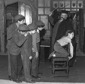 whacko headmaster caning